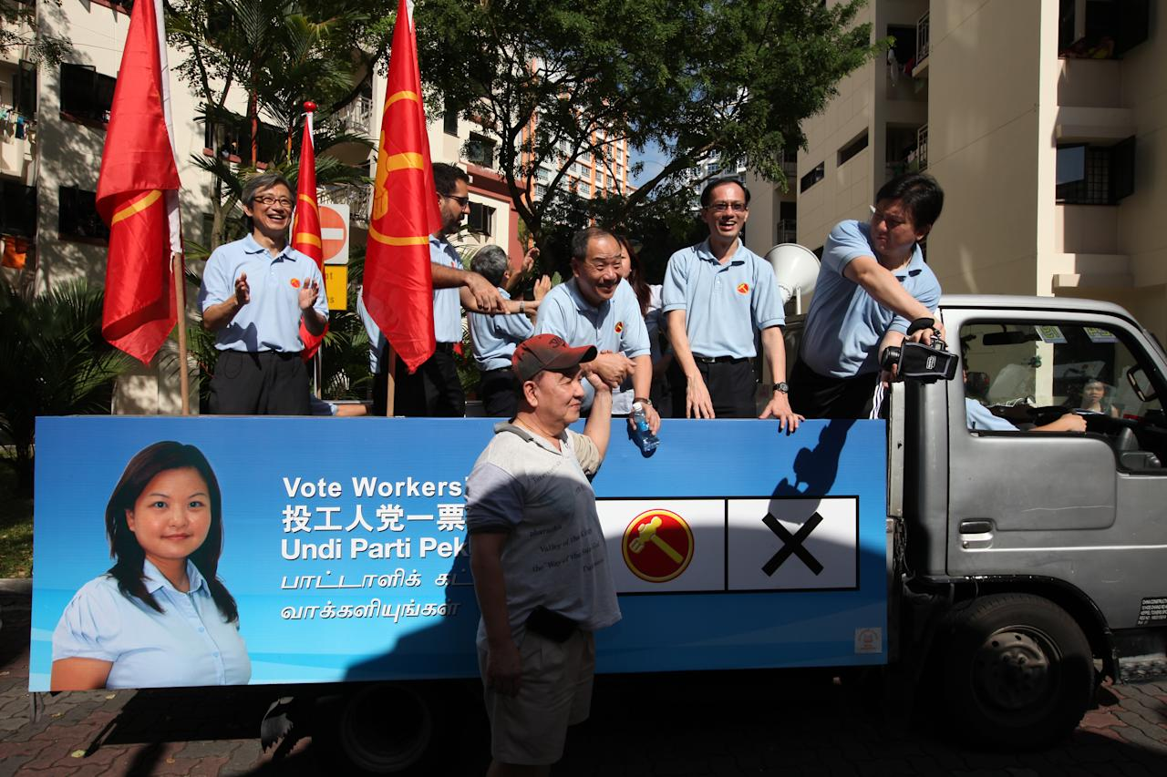 Workers Party members on board the lorry for the thank you parade.