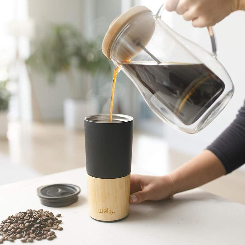 """Your friend likely already has a travel mug for their <a href=""""https://www.huffpost.com/entry/the-best-coffee-gifts-for-coffee-lovers_l_5d8d1000e4b0ac3cdda59c0e""""><strong>morning drink of choice</strong></a>, but do they have one that they actually <i>want</i> to use? <strong><a href=""""https://amzn.to/2NE8RYa"""" target=""""_blank"""" rel=""""noopener noreferrer"""">The Welly Tumbler is vacuum insulated</a></strong> and features a wide mouth and double wall keeping tea hot and cold brew and smoothies cold. The natural bamboo exterior is eco-friendly, and Welly donates 3% of sales to clean water projects worldwide. At the very least, it&rsquo;s a purchase you can feel good about. <strong><a href=""""https://amzn.to/2NE8RYa"""" target=""""_blank"""" rel=""""noopener noreferrer"""">Get it on Amazon</a></strong>."""