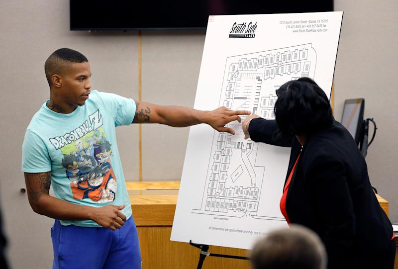 In this Tuesday, Sept. 24, 2019, photo, victim Botham Jean's neighbor Joshua Brown, left, answers questions from Assistant District Attorney LaQuita Long, right, while testifying during the murder trial of former Dallas Police Officer Amber Guyger, in Dallas. Authorities say that Brown was killed in a shooting Friday, Oct. 4.
