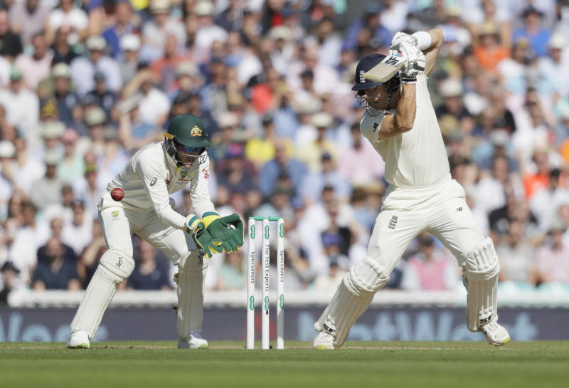 England's Joe Denly plays a shot off the bowling of Australia's Nathan Lyon during the third day of the fifth Ashes test match between England and Australia at the Oval cricket ground in London, Saturday, Sept. 14, 2019. (AP Photo/Kirsty Wigglesworth)