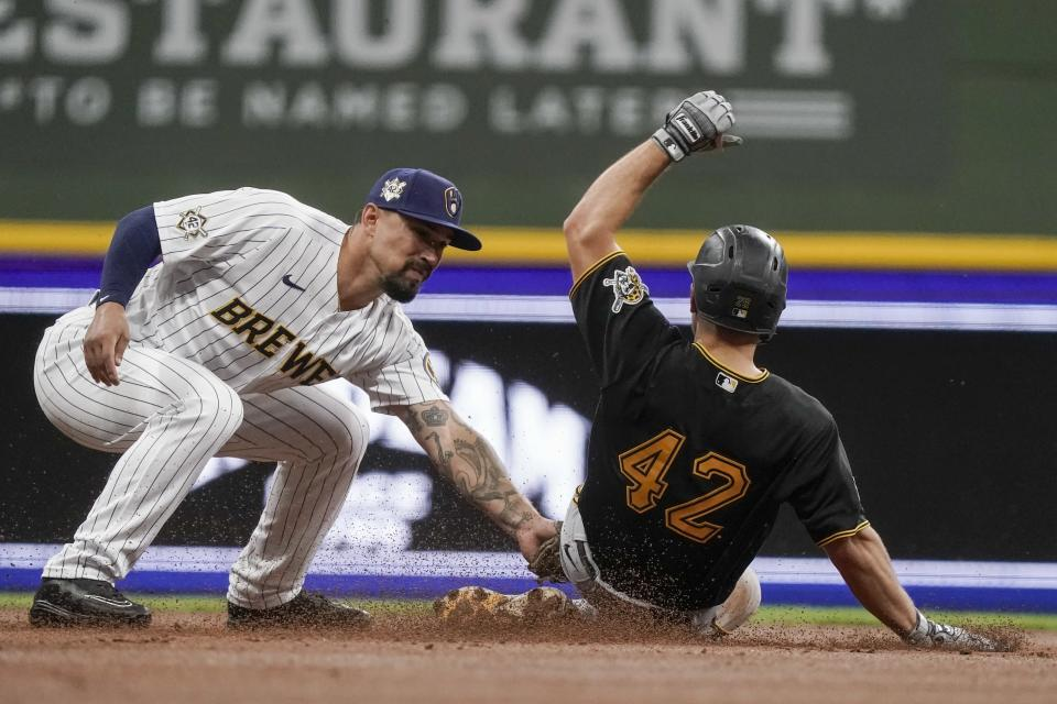 Milwaukee Brewers' Jace Peterson tags out Pittsburgh Pirates' Adam Frazier as he is caught stealing second during the third inning of a baseball game Friday, April 16, 2021, in Milwaukee. (AP Photo/Morry Gash)