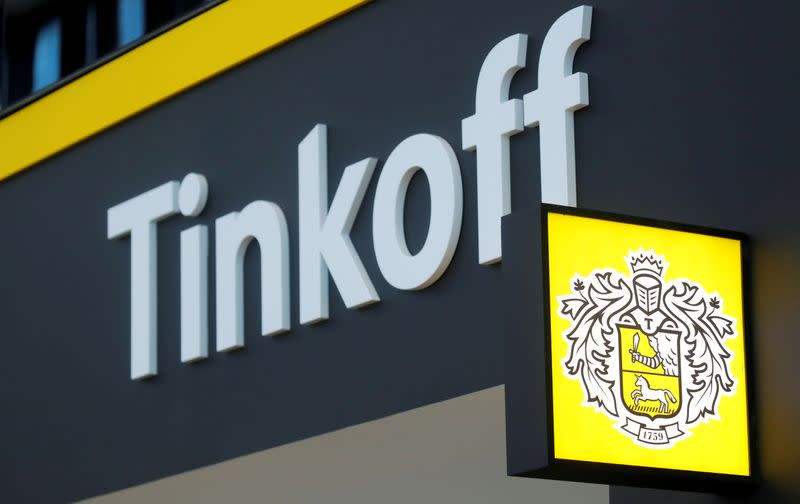 FILE PHOTO: The logo of Tinkoff Bank is seen on a board at the St. Petersburg International Economic Forum