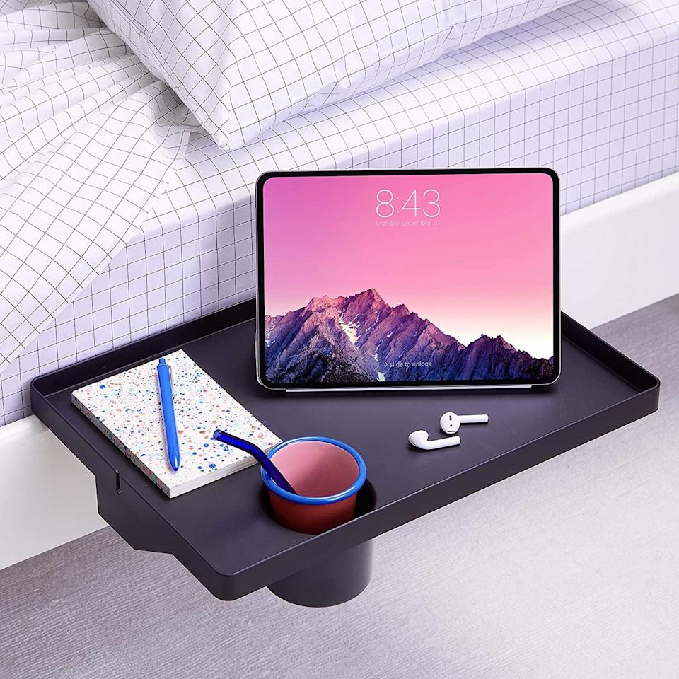 <p>Give yourself a bedside table without taking up floor space with this <span>BedShelfie Essential Bedside Shelf with Cupholder</span> ($45). The cool part about the BedShelfie is that it even works on bunk beds. It's perfect for college students and those who live in smaller spaces. </p>
