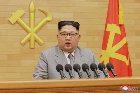 FILE PHOTO: KCNA picture of North Korea's leader Kim Jong Un speaking during a New Year's Day speech