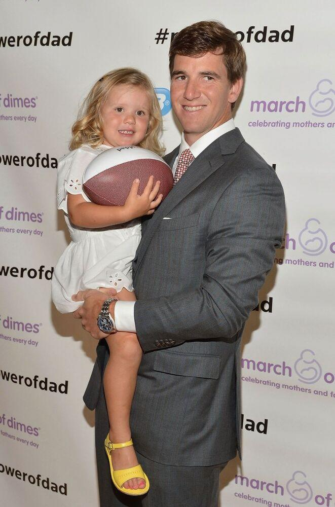 Eli Manning and daughter Ava, 2014 | Slaven Vlasic/Getty