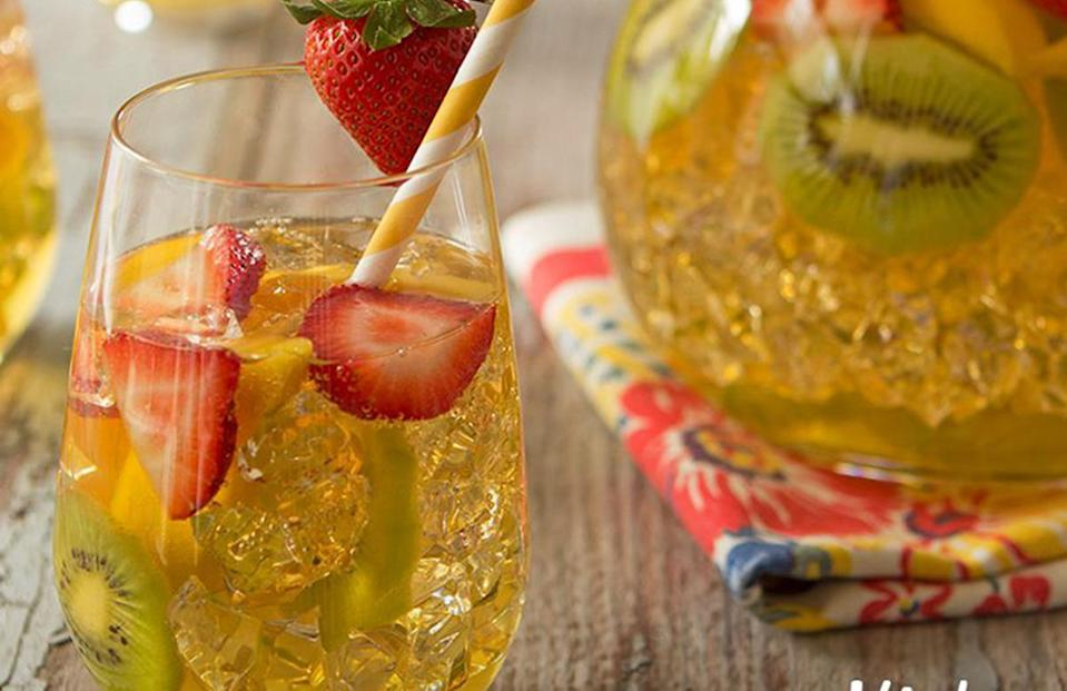 """<p>While it may be a """"kid's drink"""" perfect for <a href=""""https://www.theactivetimes.com/home/indoor-activities-kids-home?referrer=yahoo&category=beauty_food&include_utm=1&utm_medium=referral&utm_source=yahoo&utm_campaign=feed"""" rel=""""nofollow noopener"""" target=""""_blank"""" data-ylk=""""slk:kids stuck at home"""" class=""""link rapid-noclick-resp"""">kids stuck at home</a>, this tropical sparkler can be enjoyed by just about anyone. Mix white grape and tropical-flavored juices with a bit of lemon juice, then add in some strawberries, kiwi and mango along with ginger ale for a fruity, fizzy refresher.</p> <p><a href=""""https://www.thedailymeal.com/recipe/tropical-sparkler-drinks?referrer=yahoo&category=beauty_food&include_utm=1&utm_medium=referral&utm_source=yahoo&utm_campaign=feed"""" rel=""""nofollow noopener"""" target=""""_blank"""" data-ylk=""""slk:For the Kid's Tropical Sparkler recipe, click here."""" class=""""link rapid-noclick-resp"""">For the Kid's Tropical Sparkler recipe, click here.</a></p>"""