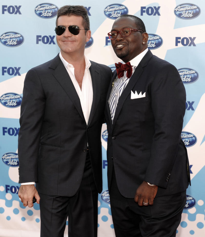"CAPTION CORRECTION: FILE - In this May 20, 2009 file photo, Judges Simon Cowell, left, and Randy Jackson arrive at the ""American Idol"" finale in Los Angeles. Jackson's announcement on Thursday, May 9, 2013, that he was departing the show means producers could plan a proper send-off for the lone remaining original judge soon, much the same way they did for Simon Cowell during the ninth season finale in 2010. (AP Photo/Chris Pizzello, File)"