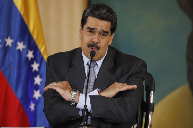 FILE - In this Sept. 30, 2019, file photo, Venezuela's President Nicolas Maduro speaks during a press conference at the Foreign Ministry in Caracas, Venezuela. The Venezuelan ambassador to Japan says his bank account has become inaccessible in Japan in what he said was apparently a consequence of President Donald Trump's decision to freeze Venezuelan assets in the United States. The Trump administration has sought to isolate Venezuelan President Nicolas Maduro by prohibiting high-ranking loyalists from entering the U.S. and by freezing U.S. assets of many included in the no-entry list. (AP Photo/Ariana Cubillos, File)