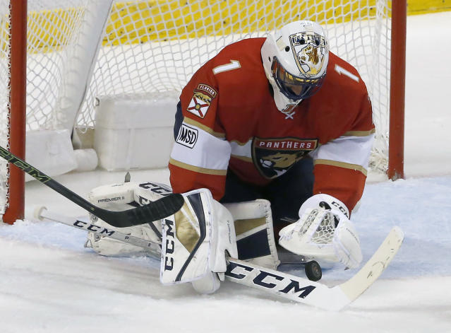 Florida Panthers goaltender Roberto Luongo (1) makes a save in the second period of play against the Carolina Hurricanes in an NHL hockey game, Monday, April 2, 2018, in Sunrise, Fla. (AP Photo/Joe Skipper)