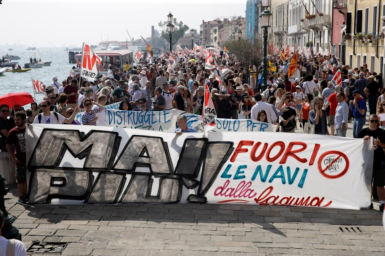 People march during a demonstration against cruise ships being allowed in the lagoon, in Venice, Italy, June 8, 2019.