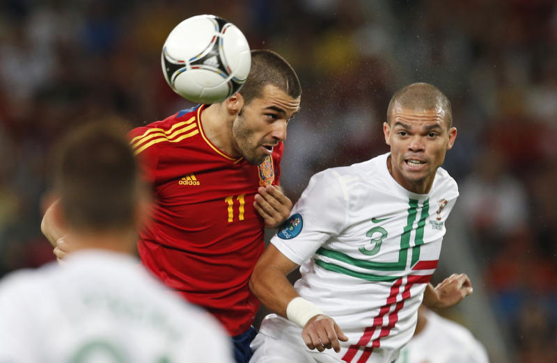 Portugal's Pepe, right, and Spain's Alvaro Negredo go for a header during the Euro 2012 soccer championship semifinal match between Spain and Portugal in Donetsk, Ukraine, Wednesday, June 27, 2012. (AP Photo/Armando Franca)