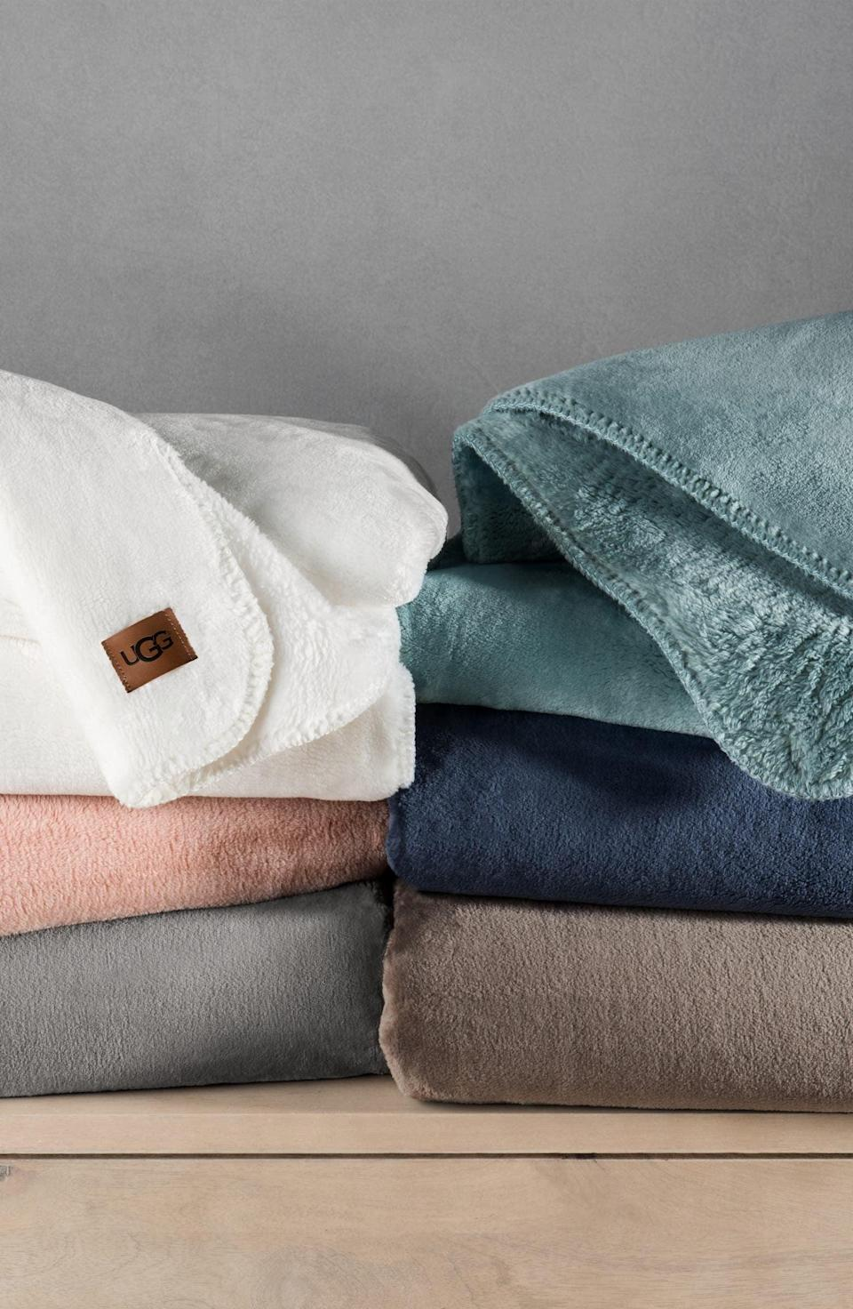 <p>The <span>Ugg Whistler Throw Blanket</span> ($98) is so freaking soft, they'll want to cocoon in it. It comes in a variety of colors, so you can get their favorite one.</p>