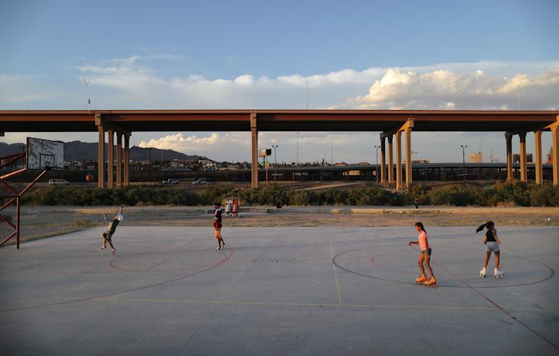 CIUDAD JUAREZ, MEXICO - JUNE 27: Kids play on the Mexican side of the U.S.-Mexico border, with the U.S. visible in the background on June 27, 2019, in Ciudad Juarez, Mexico. The Mexican government has deployed 15,000 soldiers to its border with the United States as part of a broader immigration crackdown. According to U.S. Customs and Border Protection (CBP) statistics, apprehensions along the southwest border in May of family units increased 463%, while apprehensions of unaccompanied children climbed 74%, compared to May 2018. (Photo by Mario Tama/Getty Images)