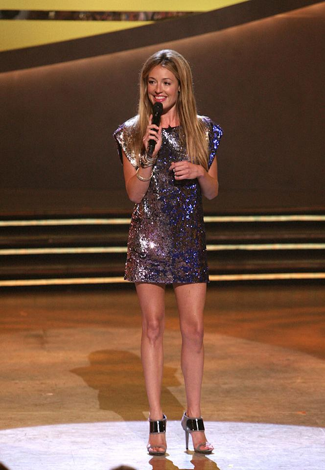 """When two of the final 10 dancers were cut on Season 5 of <a href=""""/so-you-think-you-can-dance/show/36160"""">""""So You Think You Can Dance,""""</a> <a href=""""/cat-deeley/contributor/2212390"""">Cat Deeley</a> sparkled in a Matthew Williamson sequined sheath dress, a pair of futuristic Sergio Rossi heels, and vintage bracelets."""