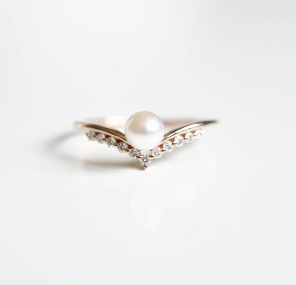 <p>A dainty Akoya pearl gently sits on the curve of this embellished <span>Pearl Wedding Ring</span> ($952 and up).</p>