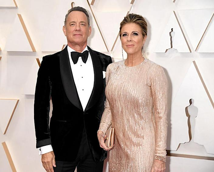 Tom Hanks and his wife Rita Wilson suffered different symptoms, pictured at the Academy Awards, February 2020. (Getty Images)