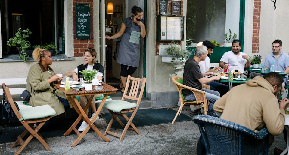 File image shows diners out of the front of a restaurant.