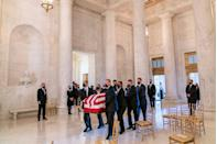 <p>The flag-draped casket of Justice Ruth Bader Ginsburg, carried by Supreme Court police officers, arrives in the Great Hall at the Supreme Court in Washington, DC, on September 23, 2020.</p>