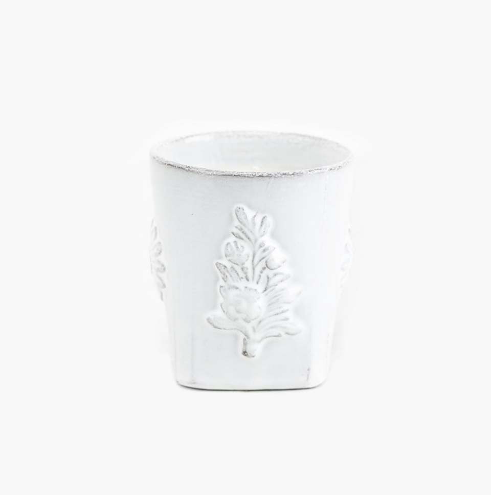 """<p><strong>Sue Fisher King</strong></p><p><strong>$140.00</strong></p><p><a href=""""https://www.suefisherking.com/grand-paradis-ceramic-candle-102942"""" rel=""""nofollow noopener"""" target=""""_blank"""" data-ylk=""""slk:BUY NOW"""" class=""""link rapid-noclick-resp"""">BUY NOW</a></p><p>""""My favorite candle is Astier de Villatte's Grand Paradis—the ceramic version. It's indulgent, but the ceramic container is beautiful and made like all of Astier's other ceramic tabletop, so you'll want to keep it after the candle is finished!"""" — <a href=""""https://urldefense.com/v3/__https://mareaclarkinteriors.com/__;!!Ivohdkk!wBoT4CyfzQ2PVEa-sb01omFgcqGjWvzQykf_RvliJRxgoUN9XuusAHpr8e98Gg772nwVzg$"""" rel=""""nofollow noopener"""" target=""""_blank"""" data-ylk=""""slk:Marea Clark"""" class=""""link rapid-noclick-resp"""">Marea Clark</a></p>"""