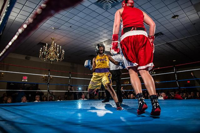 "<p>Claressa ""T-Rex"" Shields fights against former Canadian Champion Mary Spencer at a showfight in Lansing, Mich., Feb. 2013. This is 6 months after she won the Gold Medal in Woman's Boxing at the 2012 Olympics in London. (Photograph by Zackary Canepari) </p>"