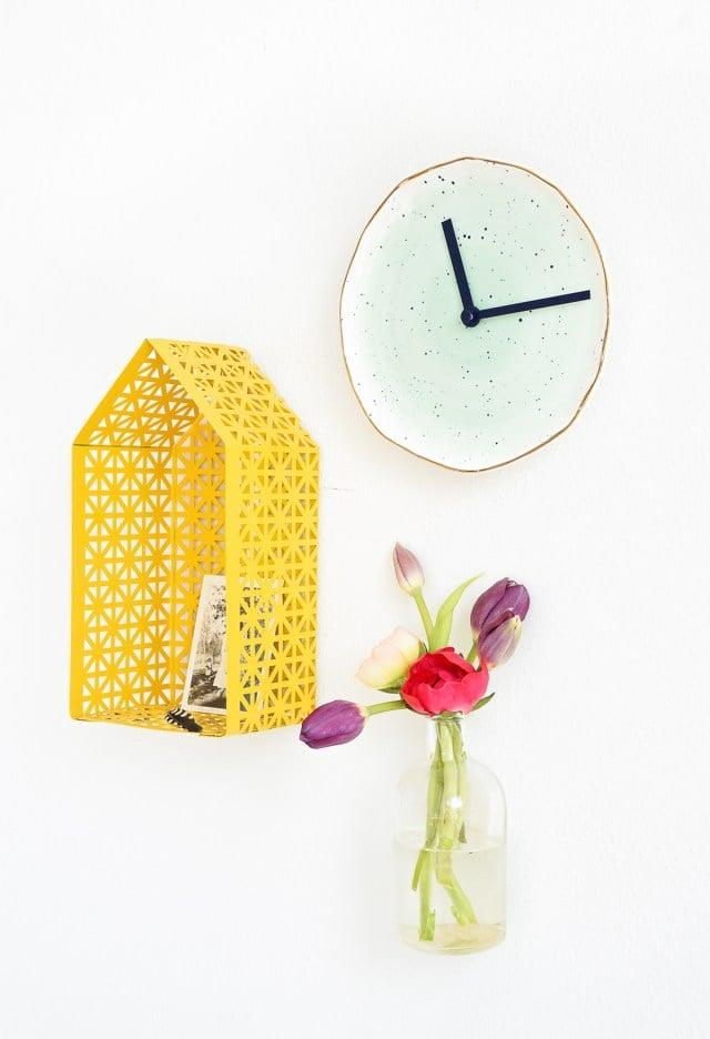 "<p>Create this cool <a href=""http://sugarandcloth.com/2016/09/diy-plate-clock/"" target=""_blank"" class=""ga-track"" data-ga-category=""Related"" data-ga-label=""http://sugarandcloth.com/2016/09/diy-plate-clock/"" data-ga-action=""In-Line Links"">DIY plate</a> from a pretty plate.</p>"
