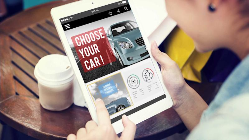 Woman car shopping online using tablet device