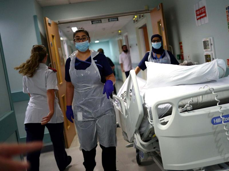 Medical staff transfer a patient along a corridor at the Royal Blackburn Teaching Hospital in Blackburn, north-west England on May 14, 2020: AFP/Getty