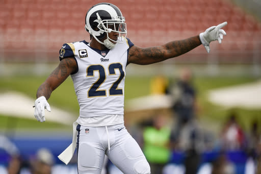 FILE - In this Sept. 17, 2017, file photo, Los Angeles Rams cornerback Trumaine Johnson (22) points during the first half of the team's NFL football game against the Washington Redskins in Los Angeles. Johnson has a huge contract and even bigger expectations from the New York Jets and their fans. That's nothing new for New York's newest cornerback, who has already established himself as one of the NFL's best at his position. And he got paid as such, signing a five-year, $72.5 million contract last week that included a $20 million signing bonus and $34 million in guaranteed money. Johnson spent his first six seasons with the Rams, (AP Photo/Kelvin Kuo)