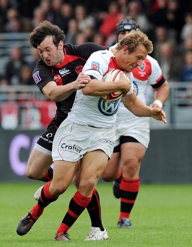Toulon's English fly-half Jonny Wilkinson (R) vies with Lyon's French wing Franck Romanet (L) during the French Top 14 rugby union match Lyon vs. Toulon on May 12, 2012 in Lyon. AFP PHOTO PHILIPPE MERLEPHILIPPE MERLE/AFP/GettyImages