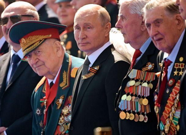 PHOTO: Russian President Vladimir Putin, center, watches the Victory Day military parade marking the 75th anniversary of the Nazi defeat in Moscow. (Sergei Guneyev/AP)