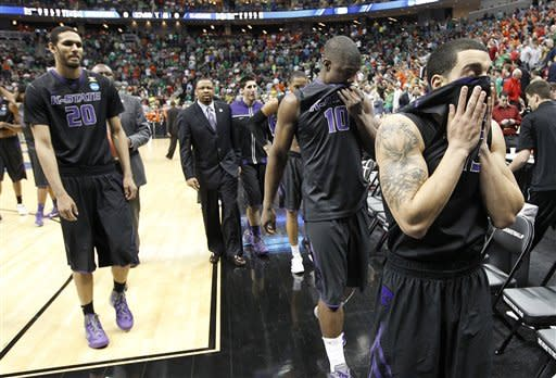 Kansas State's Angel Rodriguez, right, walks from the court with teammate Victor Ojeleye (10) and Adrian Diaz (20) after losing 75-59 to Syracuse in an NCAA tournament third-round college basketball game on Saturday, March 17, 2012 in Pittsburgh. (AP Photo/Keith Srakocic)