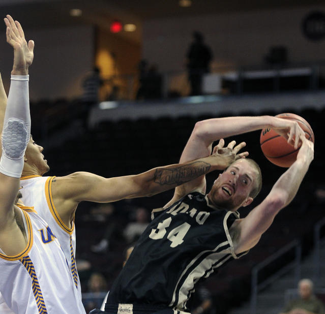 Idaho's Stephen Madison (34) loses the ball against UMKC's Nelson Kirksey, left, and Caleb Johnson during the second half of an NCAA college basketball game in the first round of the West Athletic Conference men's tournament on Thursday, March 13, 2014, in Las Vegas. Idaho won 73-70. (AP Photo/David Becker)