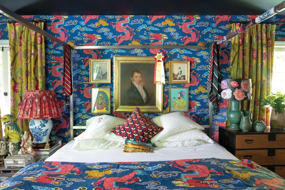 """<p>Fashion designer Johnson Hartig enveloped his own bedroom in an unexpected, gutsy dragon print (Magical Ming Dragon), creating an over-the-top wonderland you never want to leave. Caponigro describes this no-holds-barred approach of decorating as """"unconventional"""" in her book. </p>"""