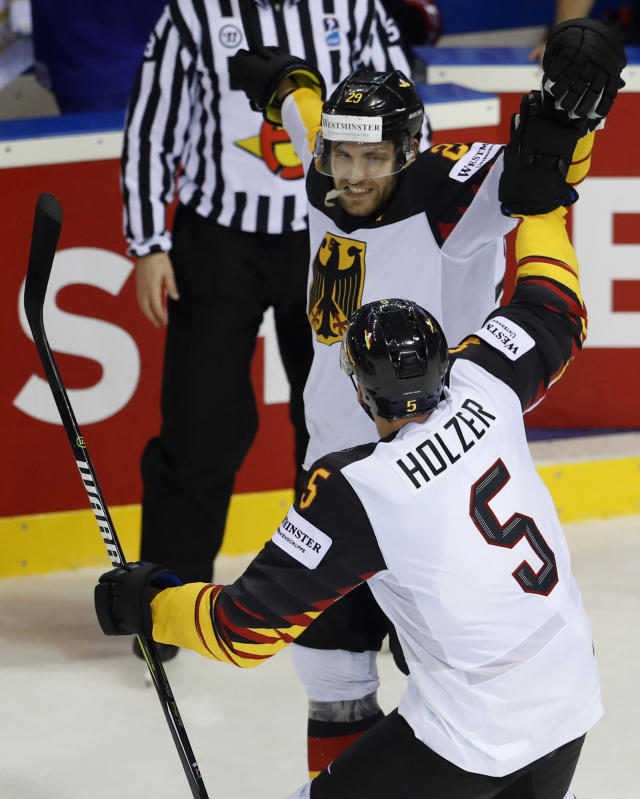 Germany's Leon Draisaitl, back, celebrates with teammate Korbinian Holzer, front, after scoring his sides winning goal during the Ice Hockey World Championships group A match between the United States and Great Britain at the Steel Arena in Kosice, Slovakia, Wednesday, May 15, 2019. (AP Photo/Petr David Josek)
