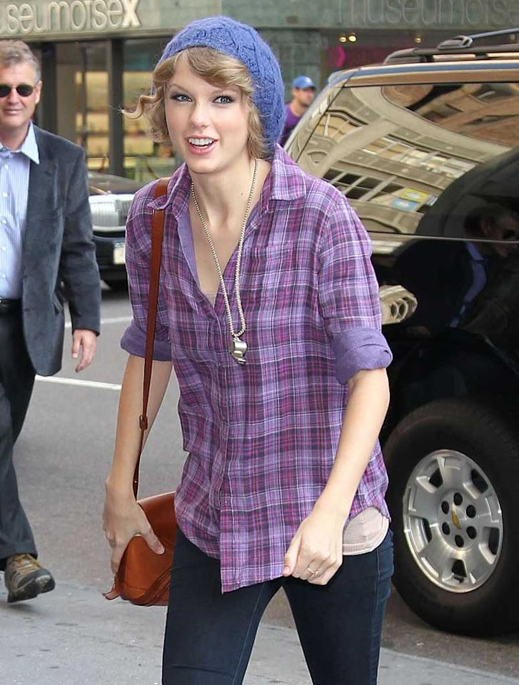 "Although Taylor Swift is known for her love of sparkling dresses on the red carpet, she goes casual every now and again, too. The country cutie was snapped sporting a purple plaid shirt and periwinkle knit cap while taking care of business in NYC. <a href=""http://www.splashnewsonline.com"" target=""new"">Splash News</a> - October 26, 2010"