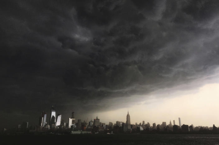 Storm clouds gather over New York City. (Photo: Denis Paquin/AP)
