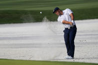 Bryson DeChambeau hits from the bunker on the 14th hole during the third round of The Players Championship golf tournament Saturday, March 13, 2021, in Ponte Vedra Beach, Fla. (AP Photo/John Raoux)