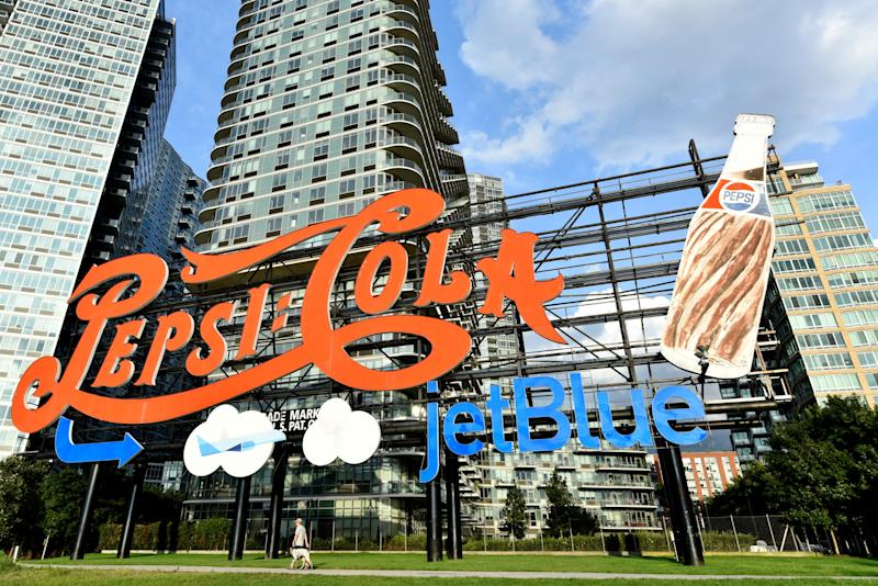 For the first time ever, PepsiCo temporarily added JetBlue branding to its world-famous Pepsi-Cola sign, which will be visible to New Yorkers and visitors through September. The temporary installation of the sign brings together the two brands in celebration of the new partnership between these two New York-based companies.