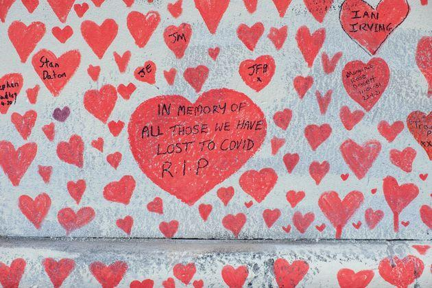 The national covid memorial wall, a sea of red love hearts remembering all those who have died due to the covid-19 pandemic.The number of people who have died within 28 days of a positive test now stands as 132,003. (Photo: Andrew Aitchison via Getty Images)