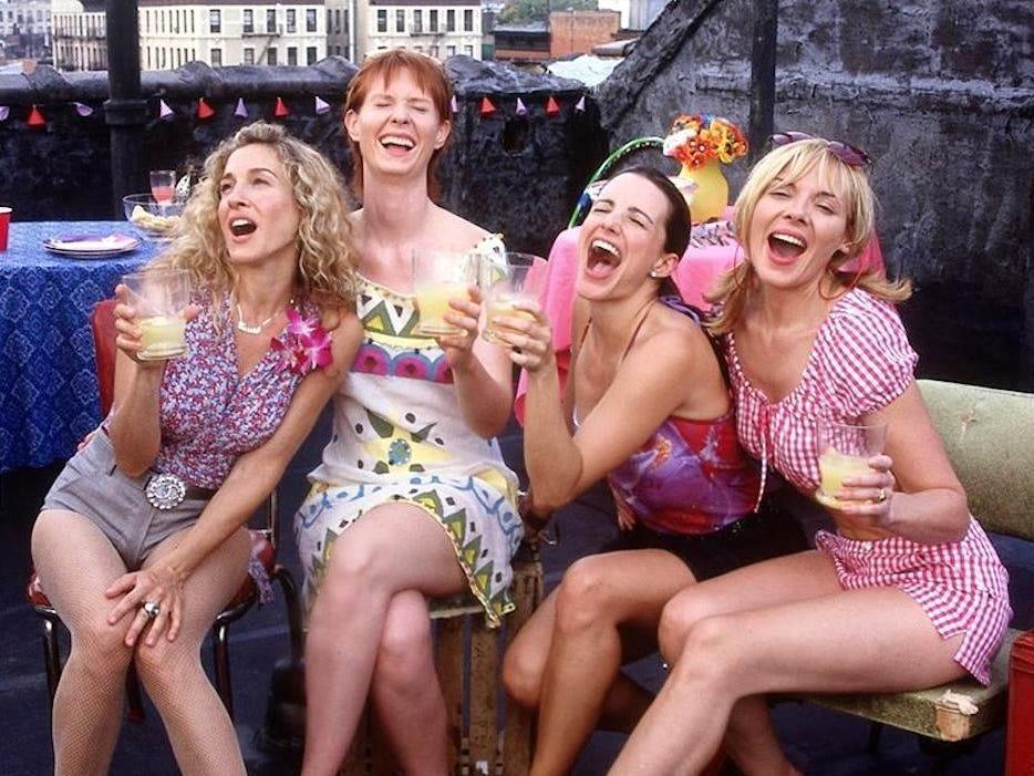 A scene of the four women laughing in Sex and the City.
