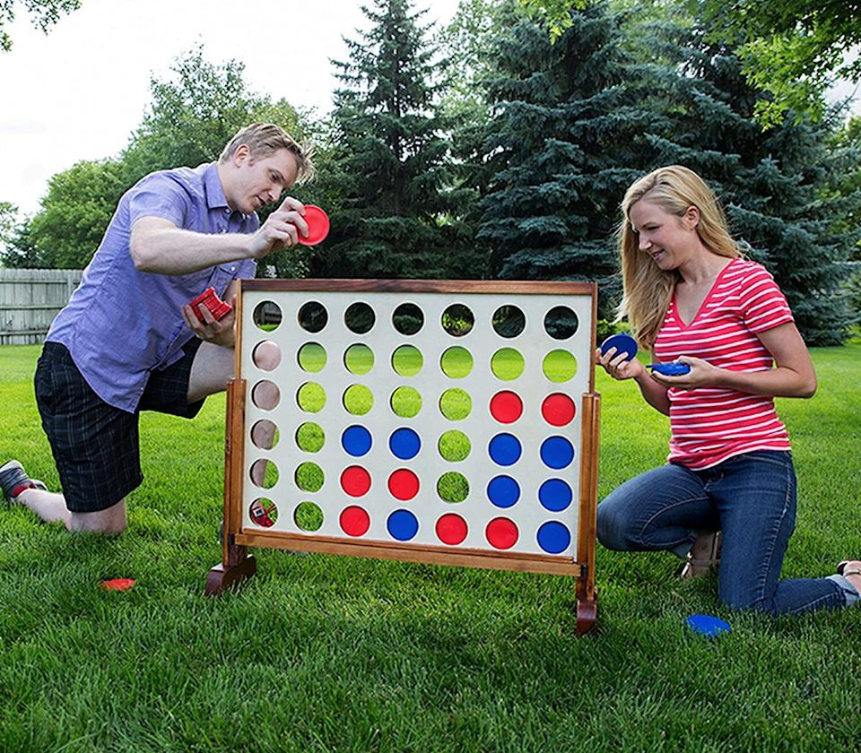 "Bring family game night outside. <br /><br /><strong>Promising review:</strong> ""This game has provided many hours of fun for family. <strong>The first day I received this, my son and husband played for four hours straight.</strong> It is a super competition and makes you think several moves ahead. Best money I have spent in a long time. The game is constructed well."" — <a href=""https://amzn.to/3ayQLSC"" target=""_blank"" rel=""nofollow noopener noreferrer"" data-skimlinks-tracking=""5580838"" data-vars-affiliate=""Amazon"" data-vars-href=""https://www.amazon.com/gp/customer-reviews/R3C51HUDL2SJYY?tag=bfgenevieve-20&ascsubtag=5580838%2C17%2C33%2Cmobile_web%2C0%2C0%2C1159925"" data-vars-keywords=""cleaning,fast fashion"" data-vars-link-id=""1159925"" data-vars-price="""" data-vars-product-id=""16176877"" data-vars-retailers=""Amazon"">Amazon Customer</a><br /><br /><strong>Get it from Amazon for <a href=""https://amzn.to/3neQZU3"" target=""_blank"" rel=""nofollow noopener noreferrer"" data-skimlinks-tracking=""5580838"" data-vars-affiliate=""Amazon"" data-vars-asin=""B014PZ36NS"" data-vars-href=""https://www.amazon.com/dp/B014PZ36NS?tag=bfgenevieve-20&ascsubtag=5580838%2C17%2C33%2Cmobile_web%2C0%2C0%2C1159945"" data-vars-keywords=""cleaning,fast fashion"" data-vars-link-id=""1159945"" data-vars-price="""" data-vars-product-id=""15928371"" data-vars-product-img=""https://m.media-amazon.com/images/I/51p6QvdLdcL.jpg"" data-vars-product-title=""Giant 4 Connect in a Row with Carrying Case and Stained and Finished Legs and Frame"" data-vars-retailers=""Amazon"">$72.99</a>.</strong>"
