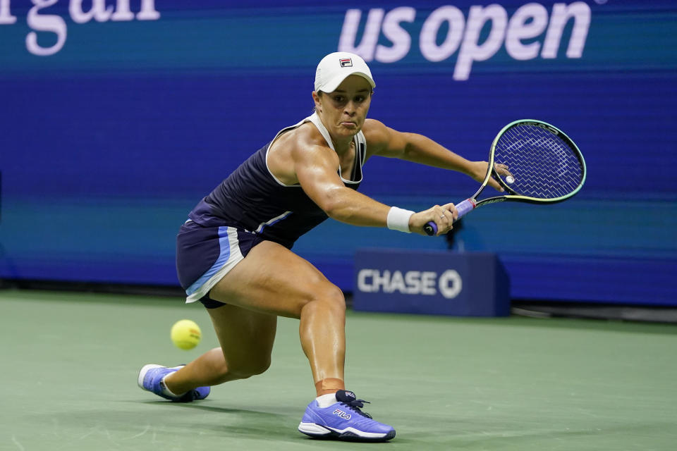 Ashleigh Barty, of Australia, returns a shot to Shelby Rogers, of the United States, during the third round of the US Open tennis championships, Saturday, Sept. 4, 2021, in New York. (AP Photo/Frank Franklin II)