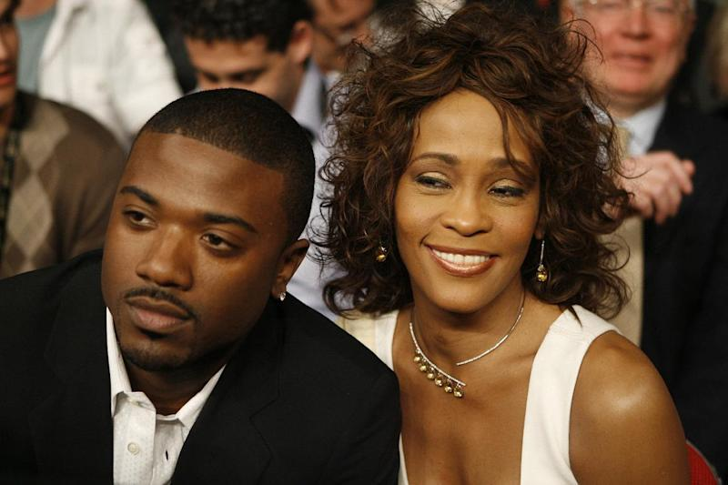 "FILE - In this April 19, 2008 file photo, singers Ray J, left, and Whitney Houston attend the Bernard Hopkins and Joe Calzaghe, of Britain, light heavyweight boxing match at the Thomas & Mack center in Las Vegas. Ray J says he's ""still hurting"" nearly a month after the death of Whitney Houston.  The singer and sometime reality television star was one of the people who spent time with Houston in her last days.  (AP Photo/Isaac Brekken, file)"
