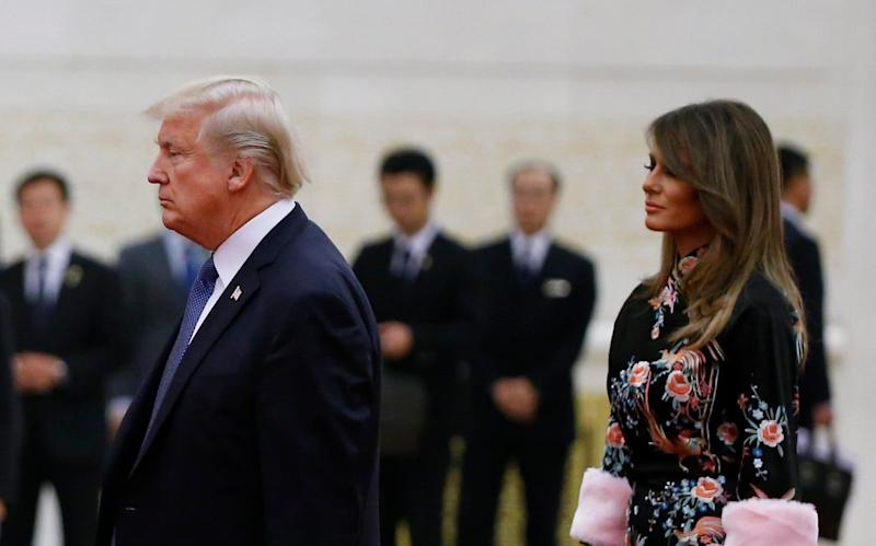 Donald Trump and first lady Melania were treated to a state dinner at the Great Hall of the People in Beijing, China, last November - REUTERS POOL