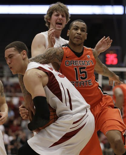 Oregon State's Eric Moreland (15) fouls Stanford's Dwight Powell, left, during the second half of an NCAA college basketball game on Sunday, Feb. 3, 2013, in Stanford, Calif. (AP Photo/Ben Margot)