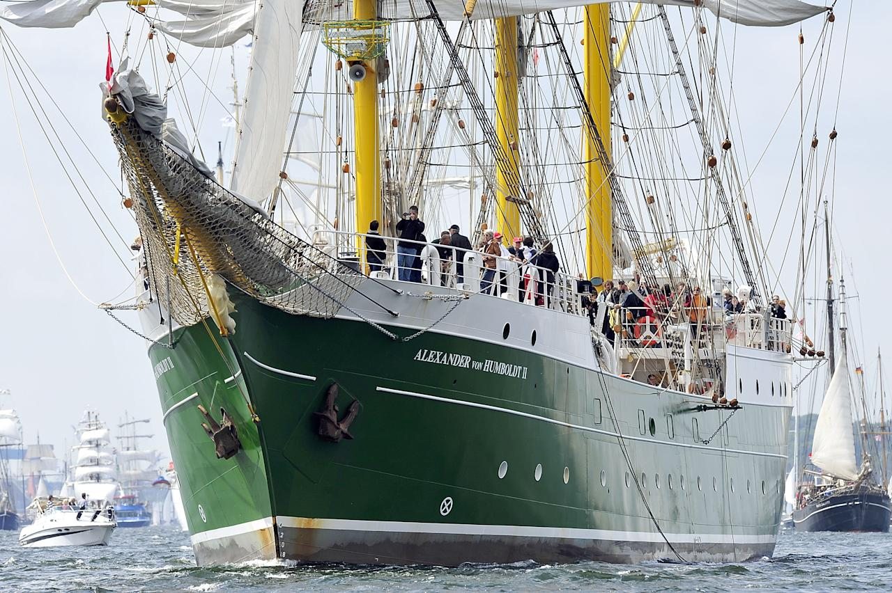 "KIEL, GERMANY - JUNE 23:  The ""Alexander von Humboldt II"" tall ship leads the Windjammer Parade of tall ships on June 23, 2012 in Kiel, Germany. The parade, which features approximately 100 tall ships and traditional large sailing ships, is the highlight of the Kieler Woche annual sailing festival, which this year is celebrating its 130th anniversary and runs from June 16-24.  (Photo by Patrick Lux/Getty Images)"