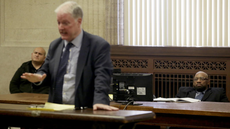 Shomari Legghette, right, appears at his murder trial as his attorney Scott Kamin speaks during opening statements on Tuesday, March 3, 2020, at the Leighton Criminal Court Building in Chicago. Legghette's accused of killing Chicago police Cmdr. Paul Bauer on Feb. 13, 2018. (Stacey Wescott/Chicago Tribune via AP, Pool)