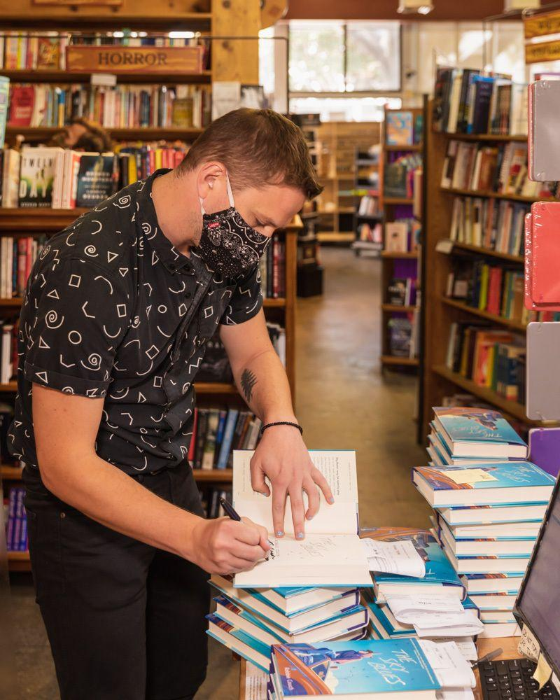 """Couch signs copies of """"The Sky Blues"""" at Skylight Books in Los Angeles. (Photo: Joseph Sebastia)"""