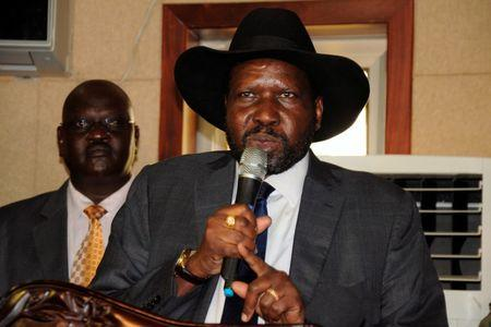 South Sudan's President Salva Kiir addresses delegates during the swearing-in ceremony of First Vice President Taban Deng Gai at the Presidential Palace in the capital of Juba