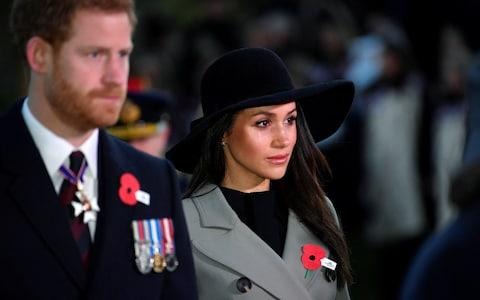 Prince Harry, who has served in the Army, with Meghan Markle during the poignant event in London - Credit: Toby Melville /PA